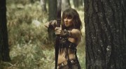 Lucy Lawless - Super City 1x02 (bra/cleavage) (MU)