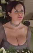 Lysette Anthony massive cleavage to go with her massive boobs ... 2 caps